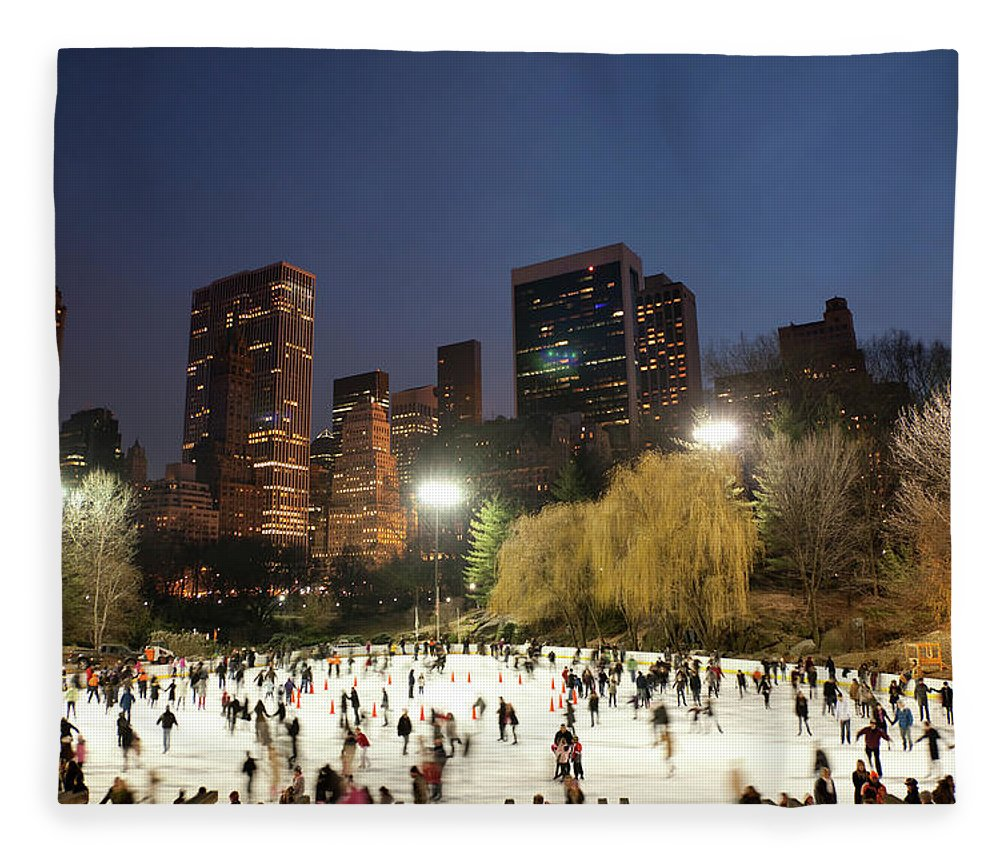 People Fleece Blanket featuring the photograph Panorama Of People Ice Skating In by Studiokiet