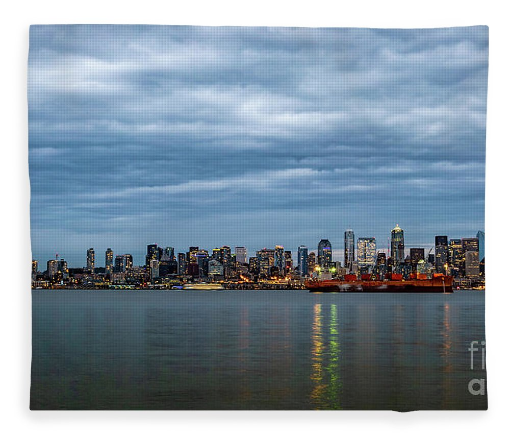 Clouds Fleece Blanket featuring the photograph Panorama Of Seattle Skyline At Night With Storm Clouds by PorqueNo Studios