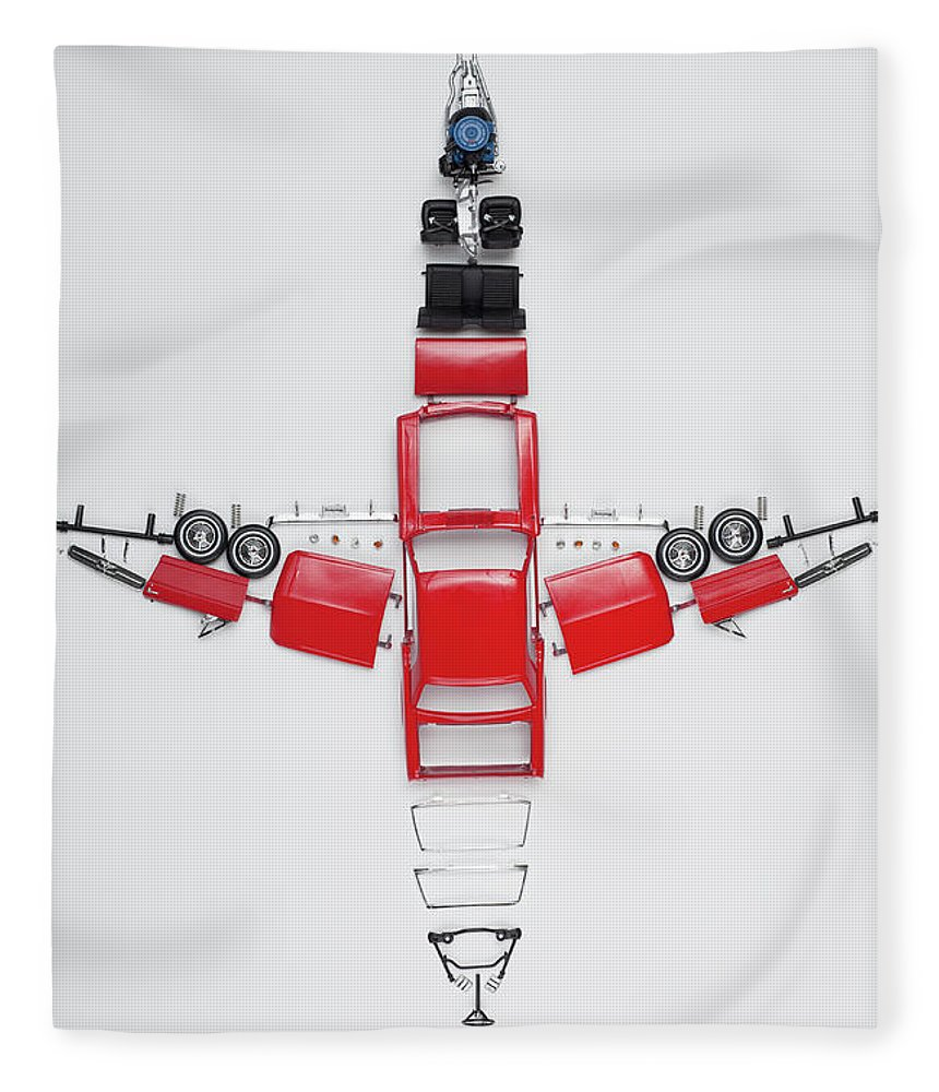 White Background Fleece Blanket featuring the photograph Parts Of A Model Car Arranged In The by Larry Washburn