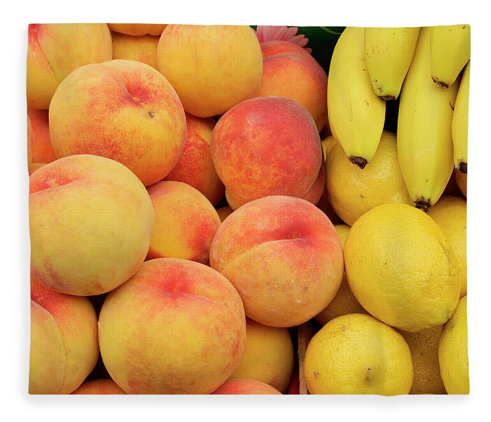 Retail Fleece Blanket featuring the photograph Peaches, Lemons And Bananas At Farmers by Travelif