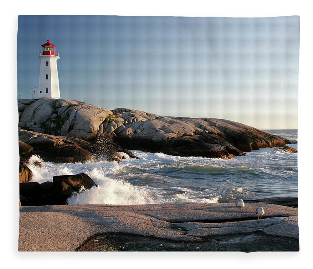 Water's Edge Fleece Blanket featuring the photograph Peggys Cove Lighthouse & Waves by Cworthy