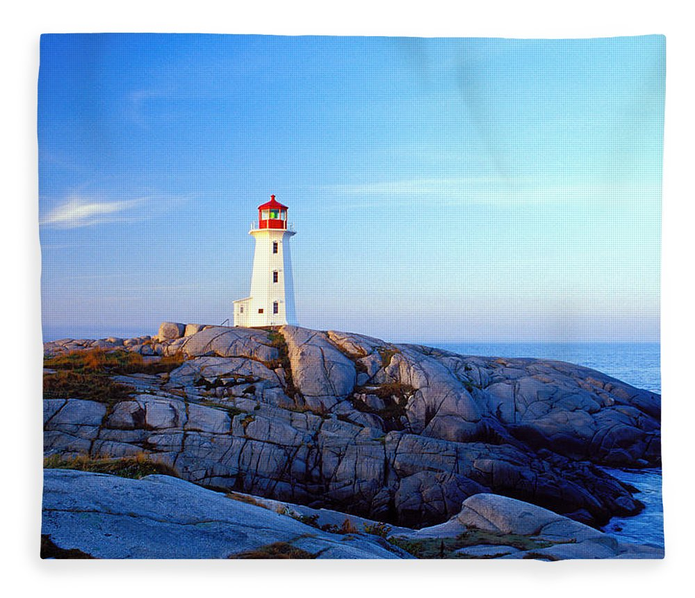 Water's Edge Fleece Blanket featuring the photograph Peggys Cove Lighthouse At Sunrise by Photorx