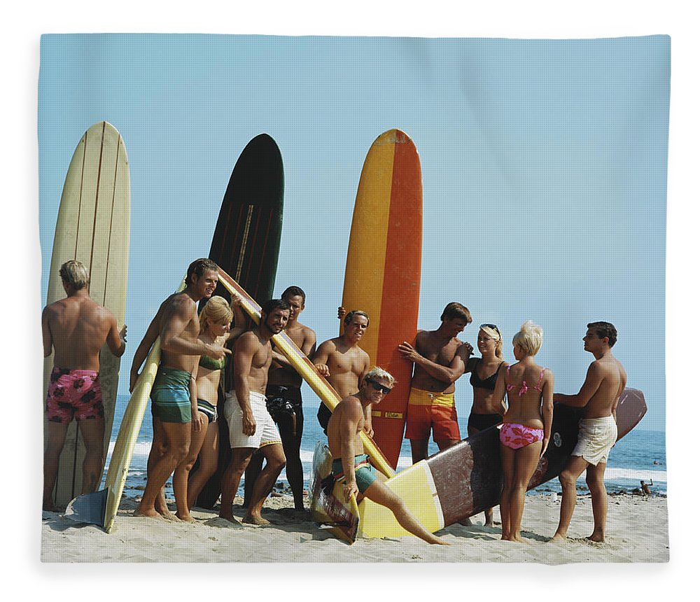 People Fleece Blanket featuring the photograph People On Beach With Surf Board by Tom Kelley Archive