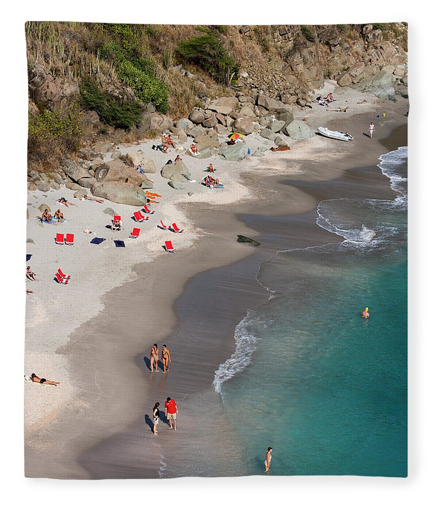 Water's Edge Fleece Blanket featuring the photograph People Relax On Shell Beach by Holger Leue