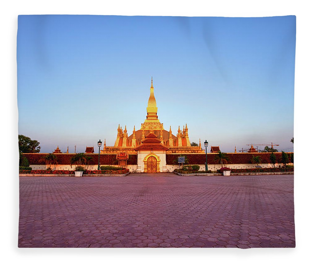 Monument Fleece Blanket featuring the photograph Pha That Luang Stupa At Sunset by Fototrav