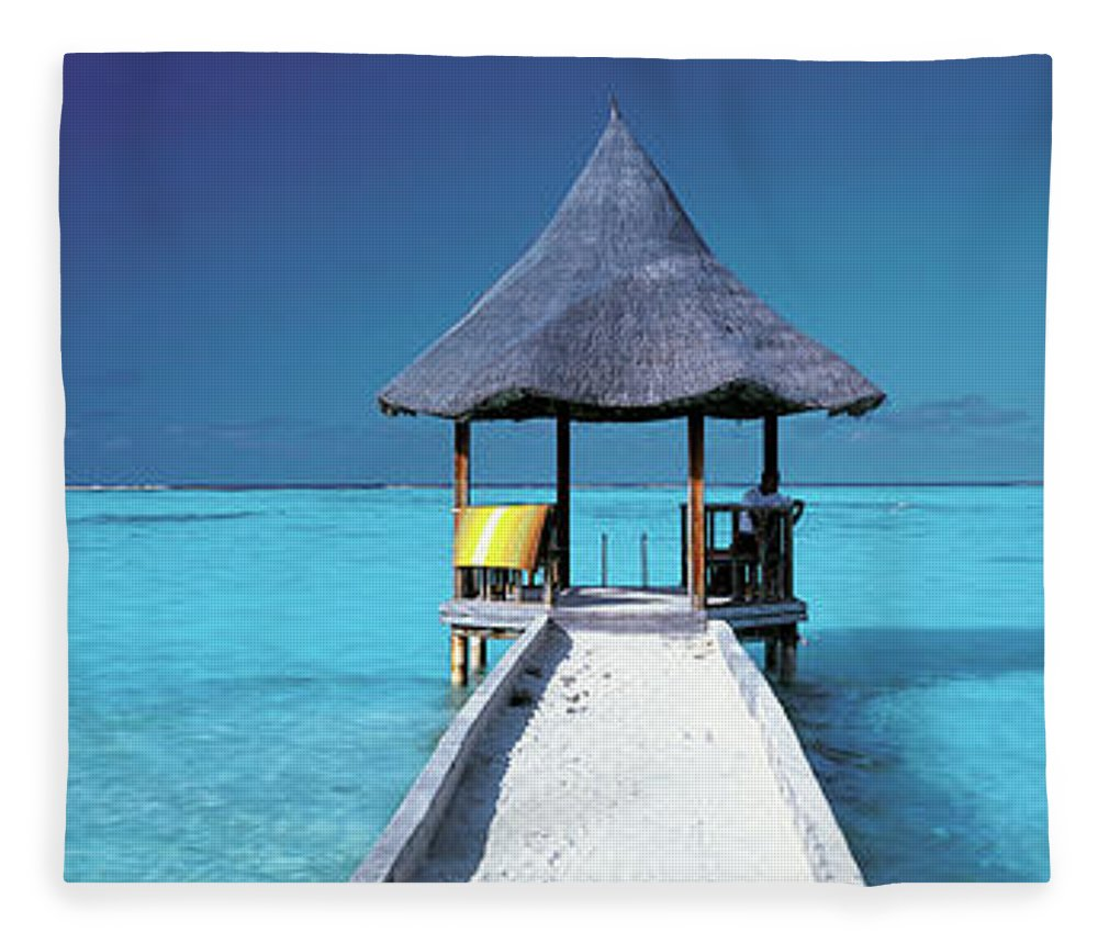 Tranquility Fleece Blanket featuring the photograph Pier And Blue Indian Ocean, Maldives by Peter Adams