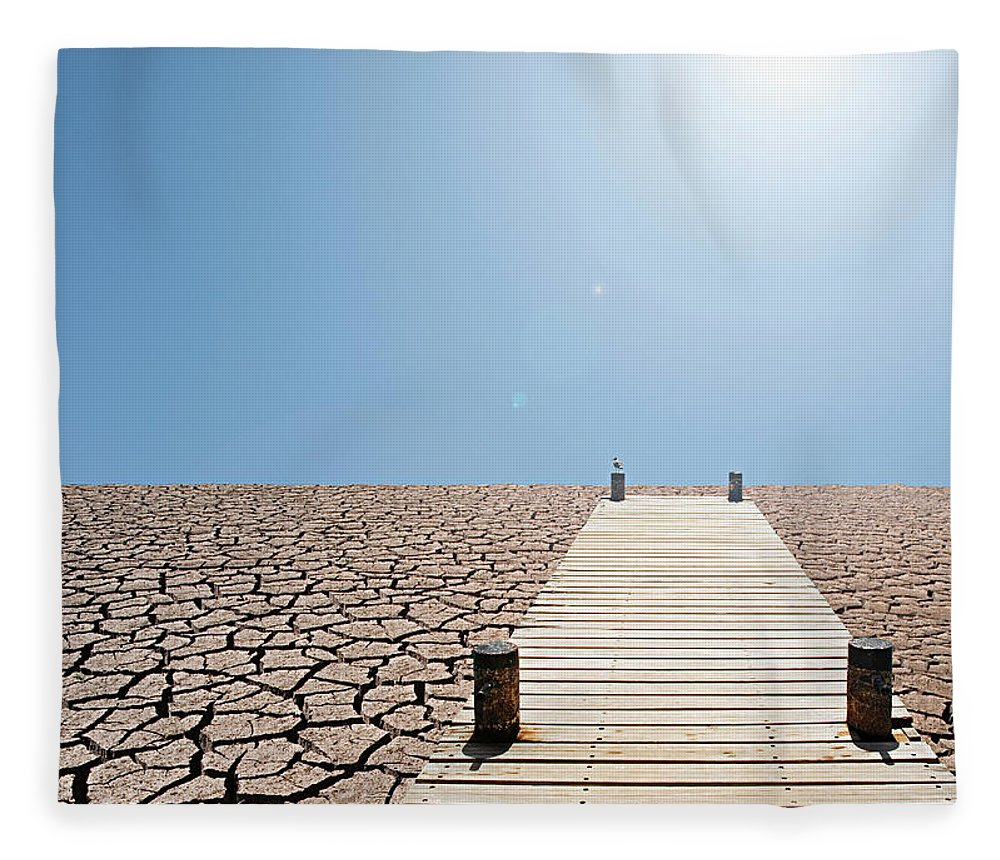 Environmental Damage Fleece Blanket featuring the photograph Pier Over A Dry Lake Bed by John Lund