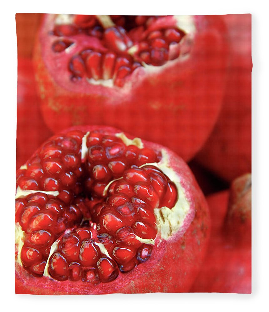 Fermenting Fleece Blanket featuring the photograph Pomegranates by Oonal