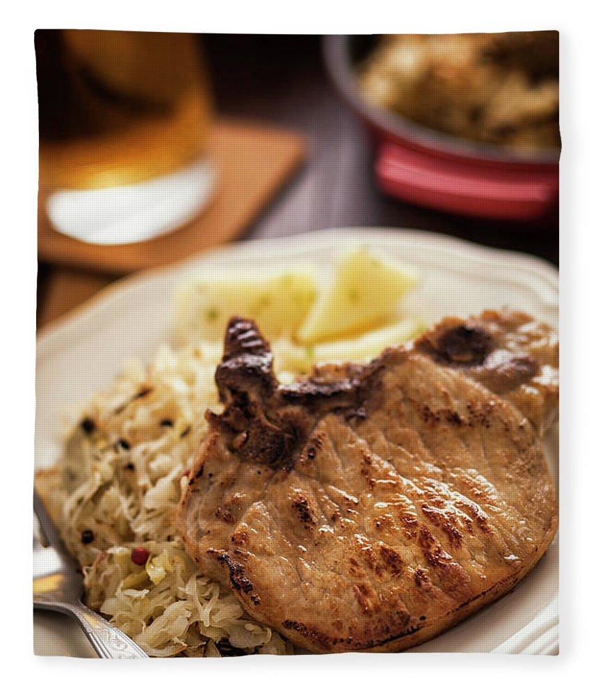 Meat Chop Fleece Blanket featuring the photograph Pork Chop And Sauerkraut by Gmvozd