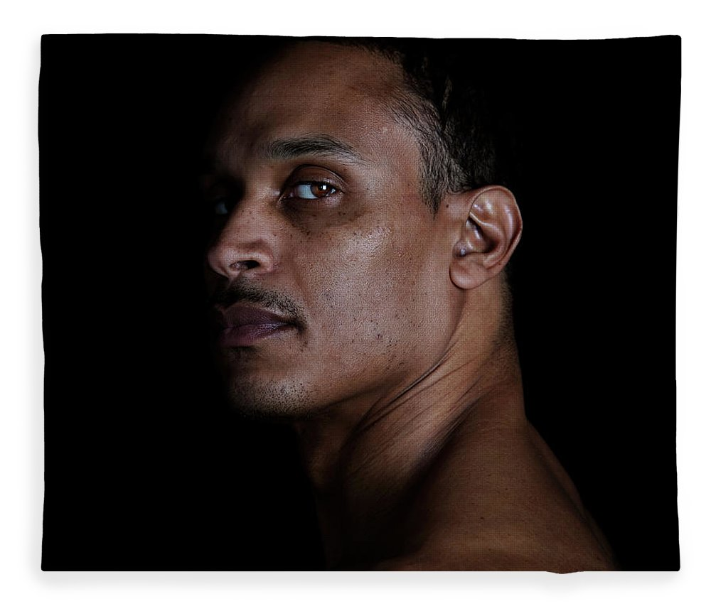 People Fleece Blanket featuring the photograph Portrait Of A Man On A Black Background by Michael Duva