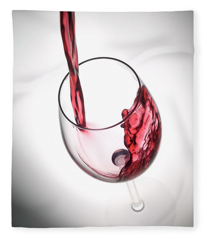 Alcohol Fleece Blanket featuring the photograph Pouring Red Wine Into A Glass by Stockcam