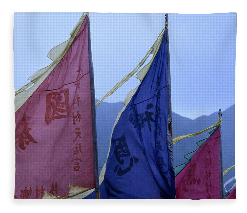Chinese Culture Fleece Blanket featuring the photograph Prayer Flags To The Sea Goddess Blow In by Lonely Planet