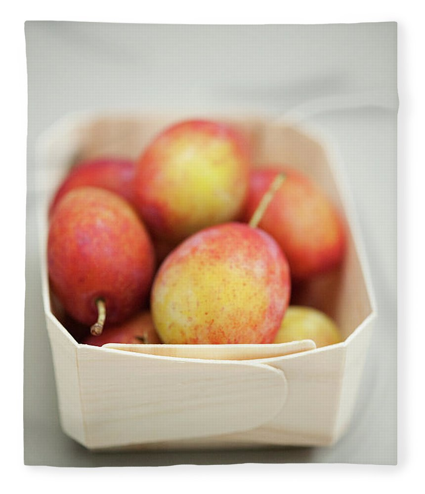 Plum Fleece Blanket featuring the photograph Punnet Of Victoria Plums by Diana Miller