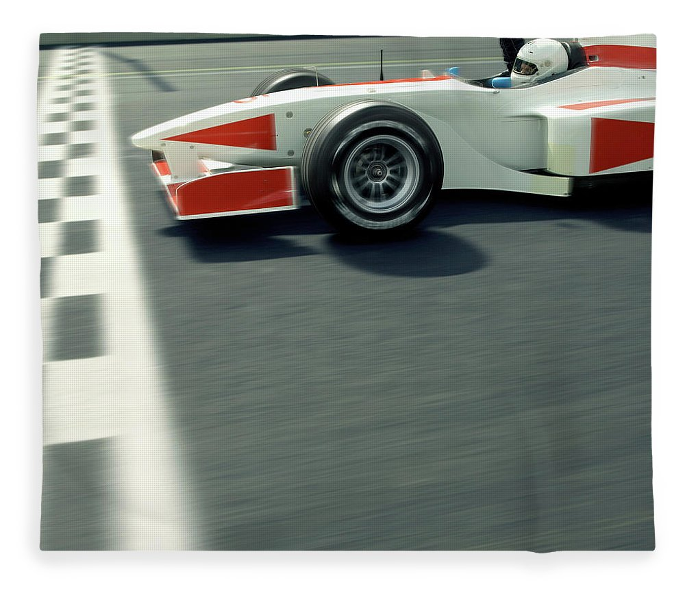 Aerodynamic Fleece Blanket featuring the photograph Racing Driver Crossing Finishing Line by Alan Thornton