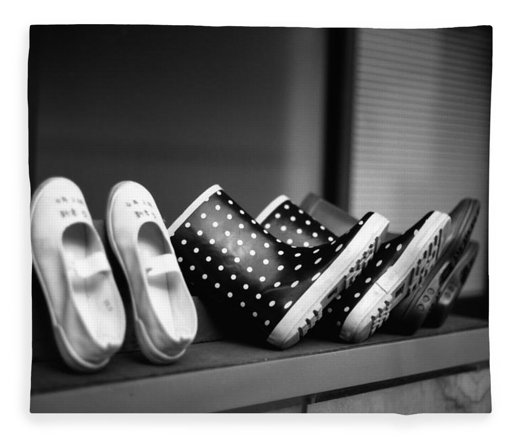 In A Row Fleece Blanket featuring the photograph Rain Shoes by Snap Shooter Jp