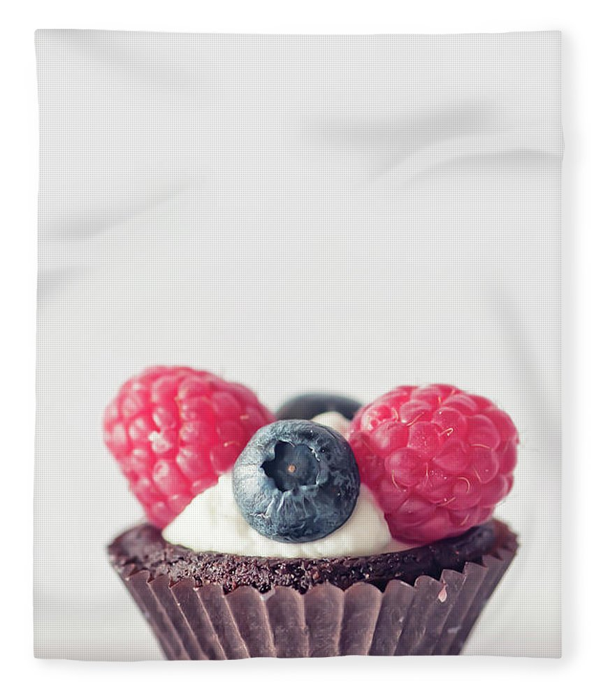 Unhealthy Eating Fleece Blanket featuring the photograph Raspberries And Blueberries Cupcake by Marta Nardini