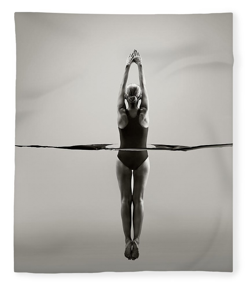 Diving Into Water Fleece Blanket featuring the photograph Rear View Of Female Swimmer by Jonathan Knowles
