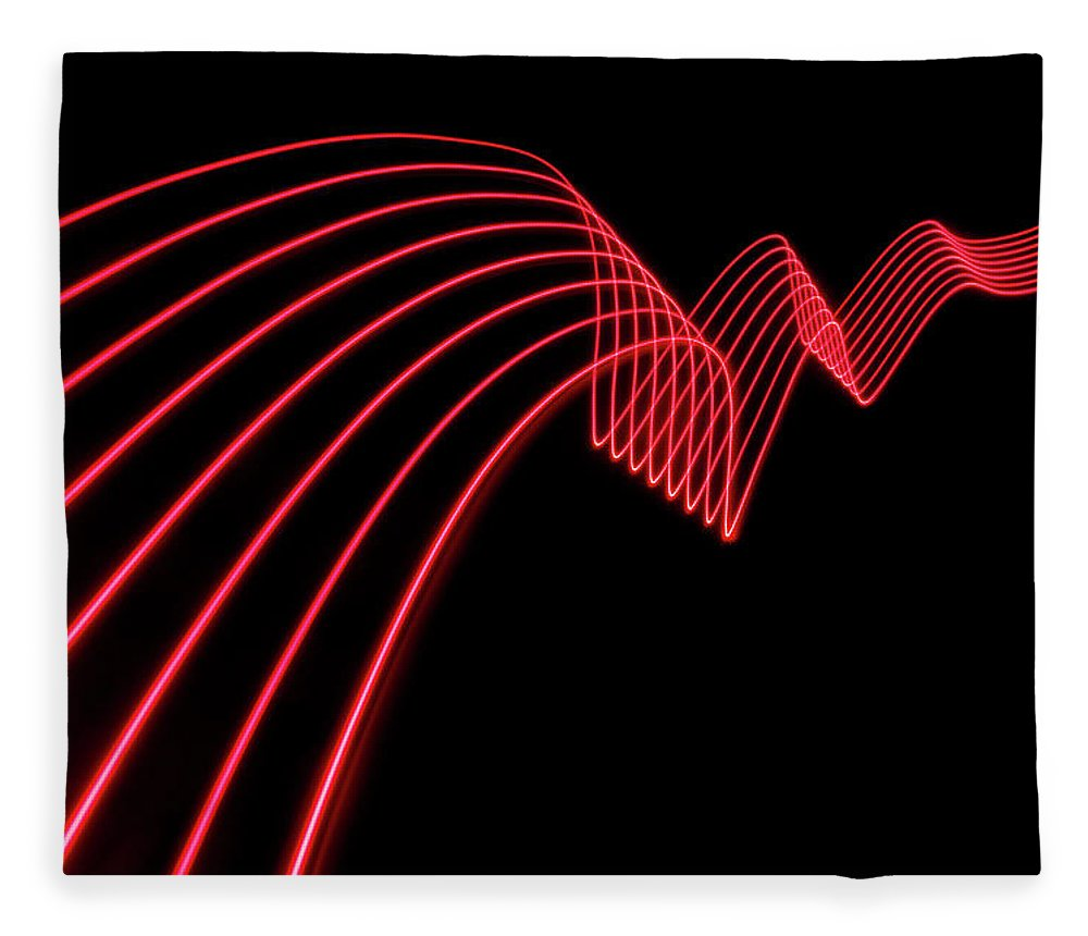 Laser Fleece Blanket featuring the photograph Red Abstract Coloured Lights Trails And by John Rensten