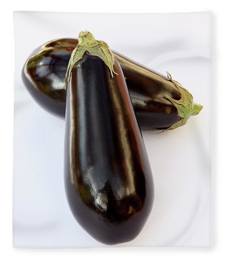 White Background Fleece Blanket featuring the photograph Ripe, Organic Aubergines On White by Rosemary Calvert