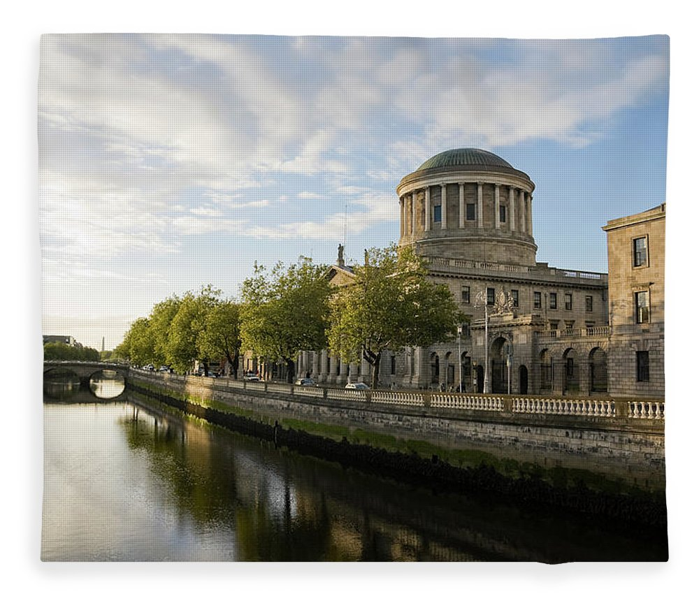 Dublin Fleece Blanket featuring the photograph River Liffey And The Four Courts In by Lleerogers