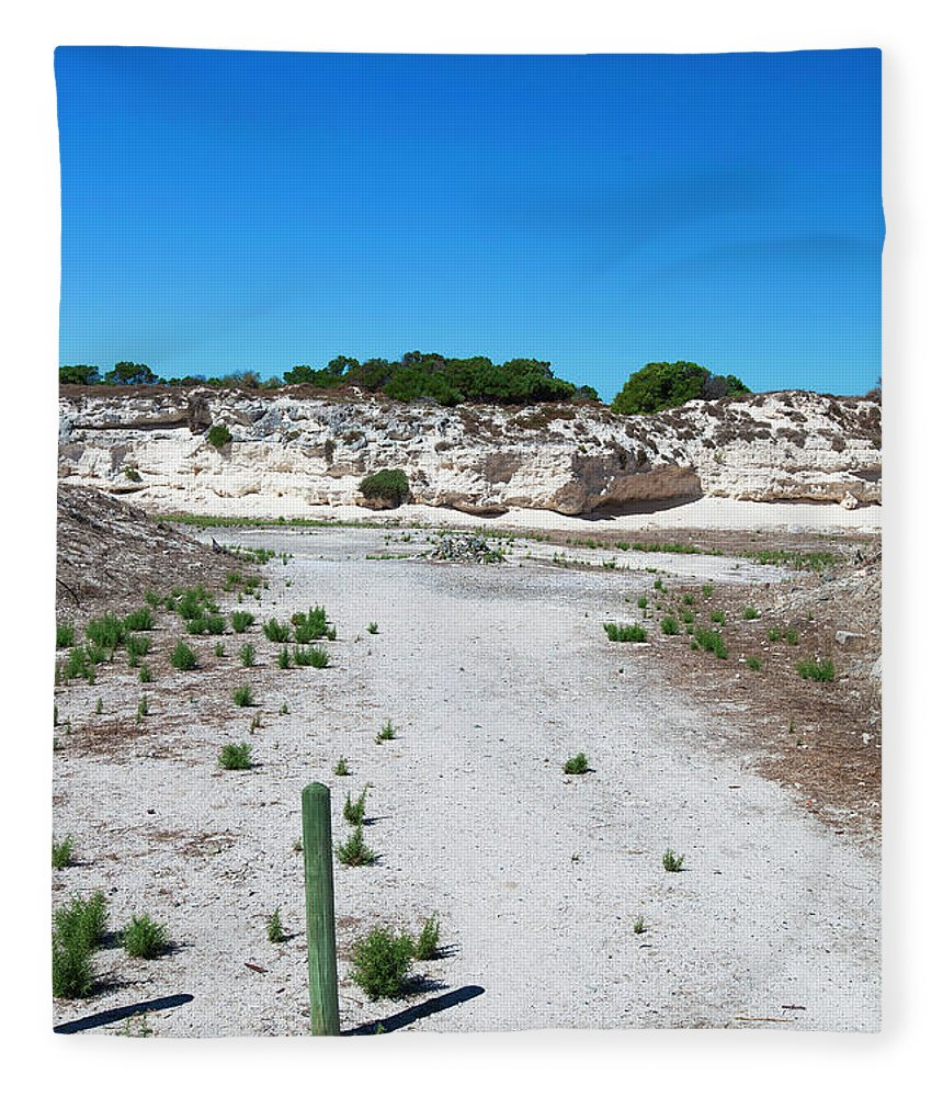 Tranquility Fleece Blanket featuring the photograph Robben Island Quarry Stone Pile by Iselin Valvik Photography