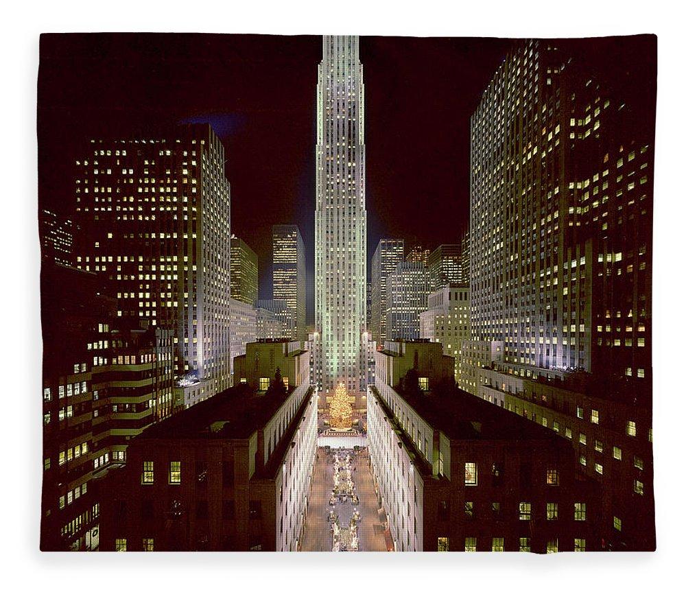 1980-1989 Fleece Blanket featuring the photograph Rockefeller Center, Manhatten, At by Thorney Lieberman