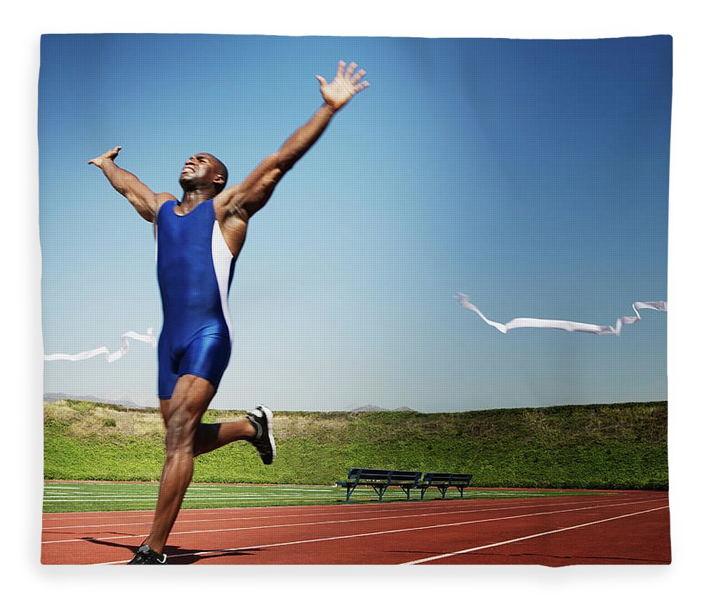 Human Arm Fleece Blanket featuring the photograph Runner Crossing Finish Line by Jupiterimages