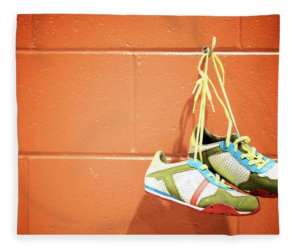 Hanging Fleece Blanket featuring the photograph Runnig Shoes Hanging On A Hook by Pascalgenest