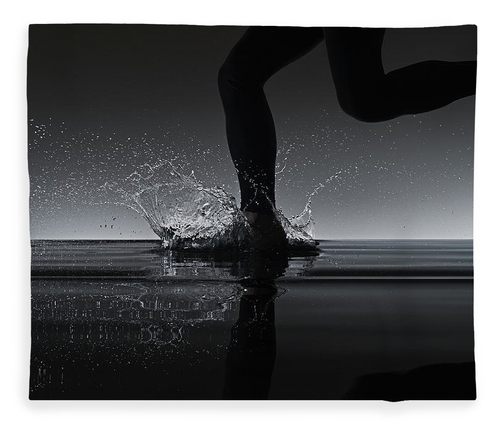 Recreational Pursuit Fleece Blanket featuring the photograph Running Through Water by Jonathan Knowles