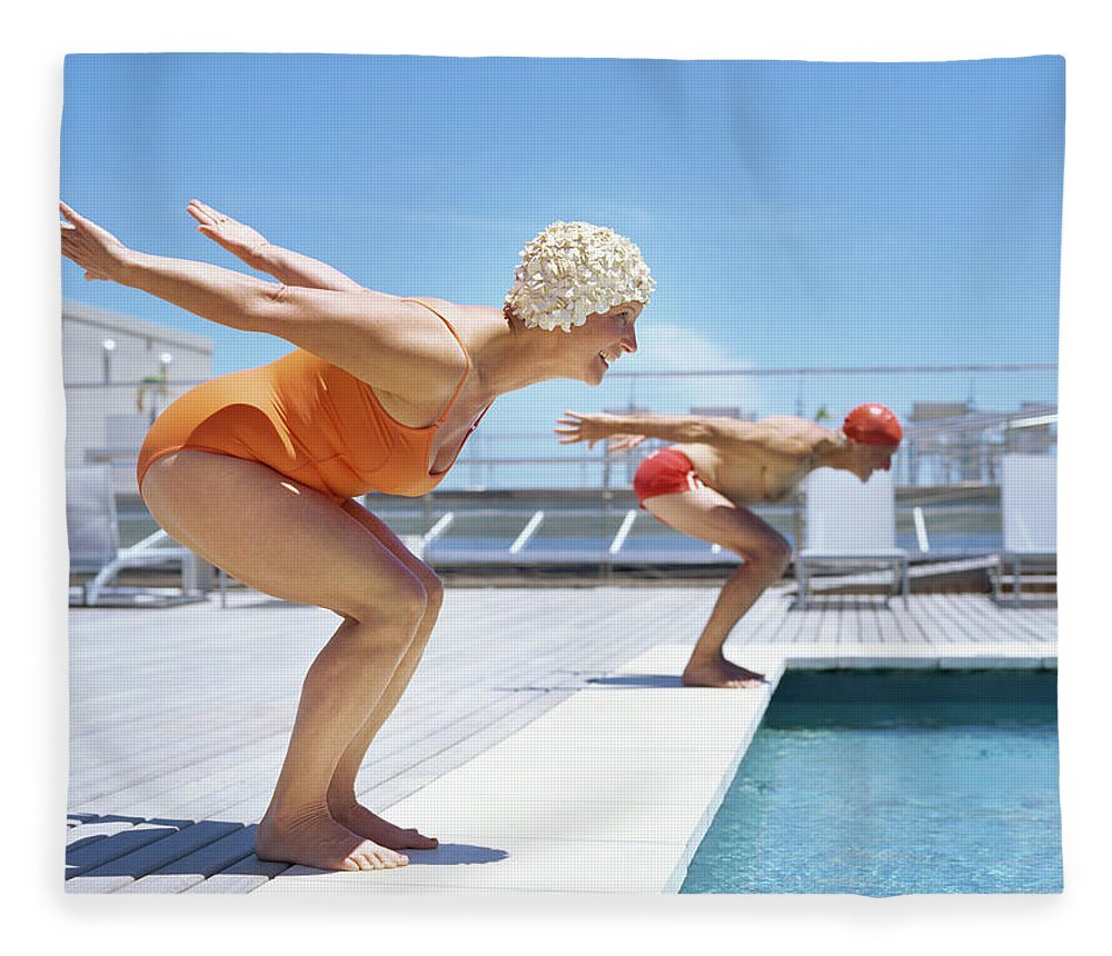 Diving Into Water Fleece Blanket featuring the photograph Senior Couple Ready To Dive In To by Stockbyte