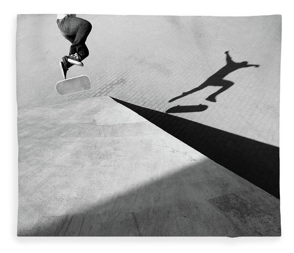 Shadow Fleece Blanket featuring the photograph Shadow Of Skateboarder by Mgs