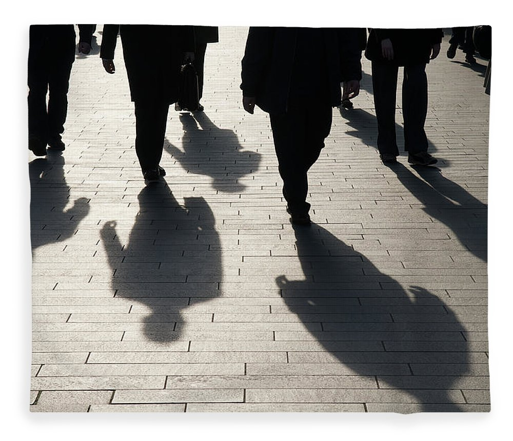Shadow Fleece Blanket featuring the photograph Shadow Team Of Commuters Walking On by Peskymonkey