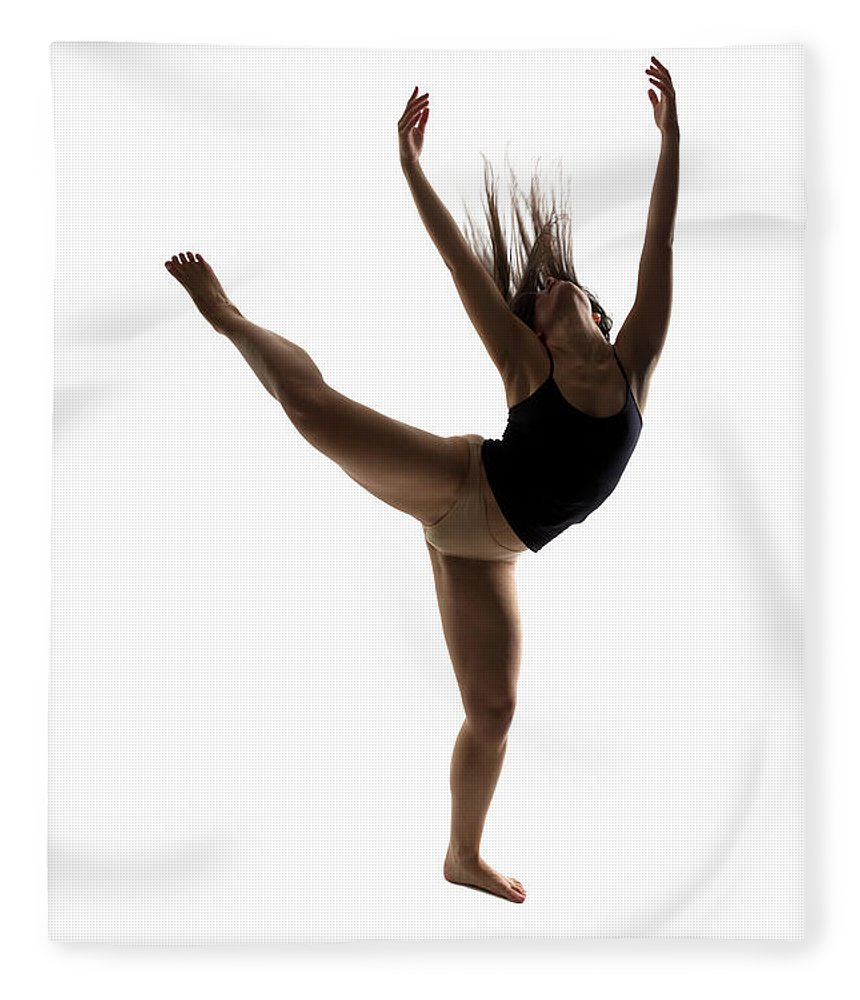 Ballet Dancer Fleece Blanket featuring the photograph Silhouette Of A Performing Dancer by Opla