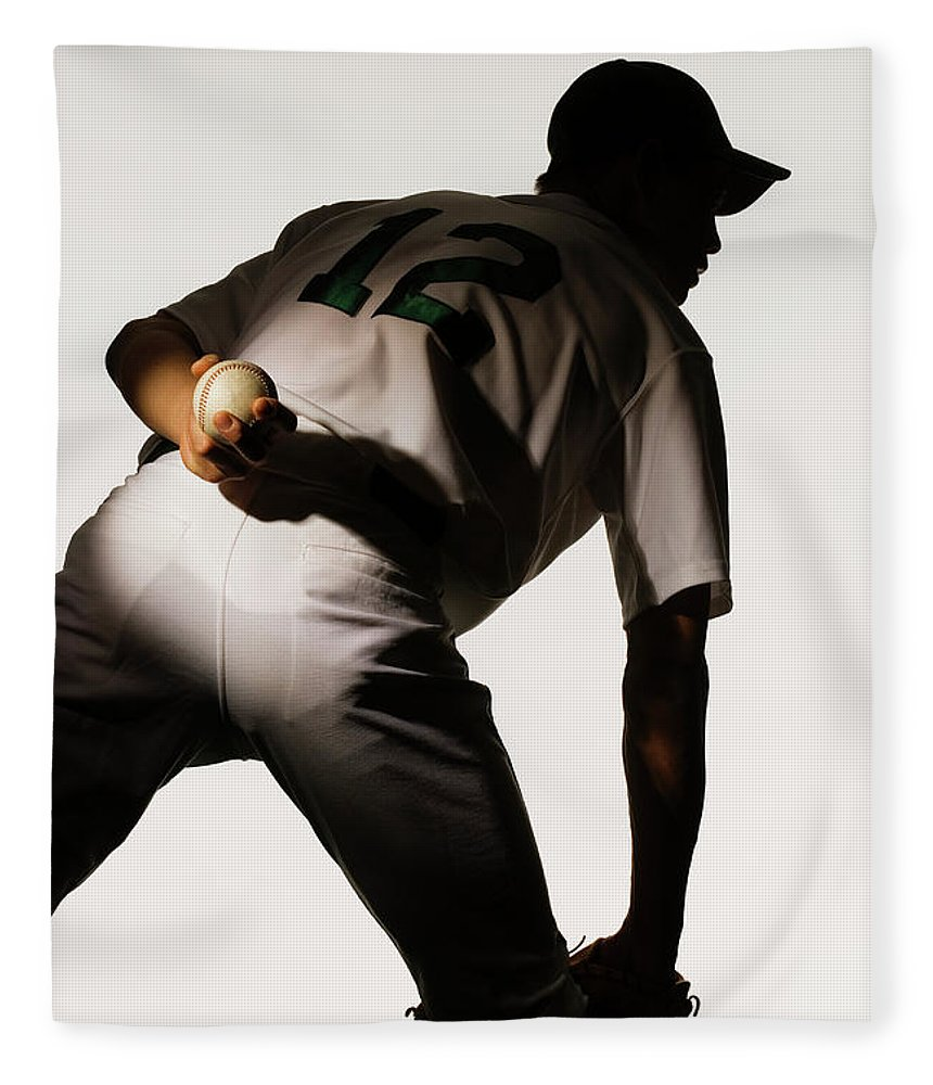 Three Quarter Length Fleece Blanket featuring the photograph Silhouette Of Baseball Pitcher Holding by Pm Images