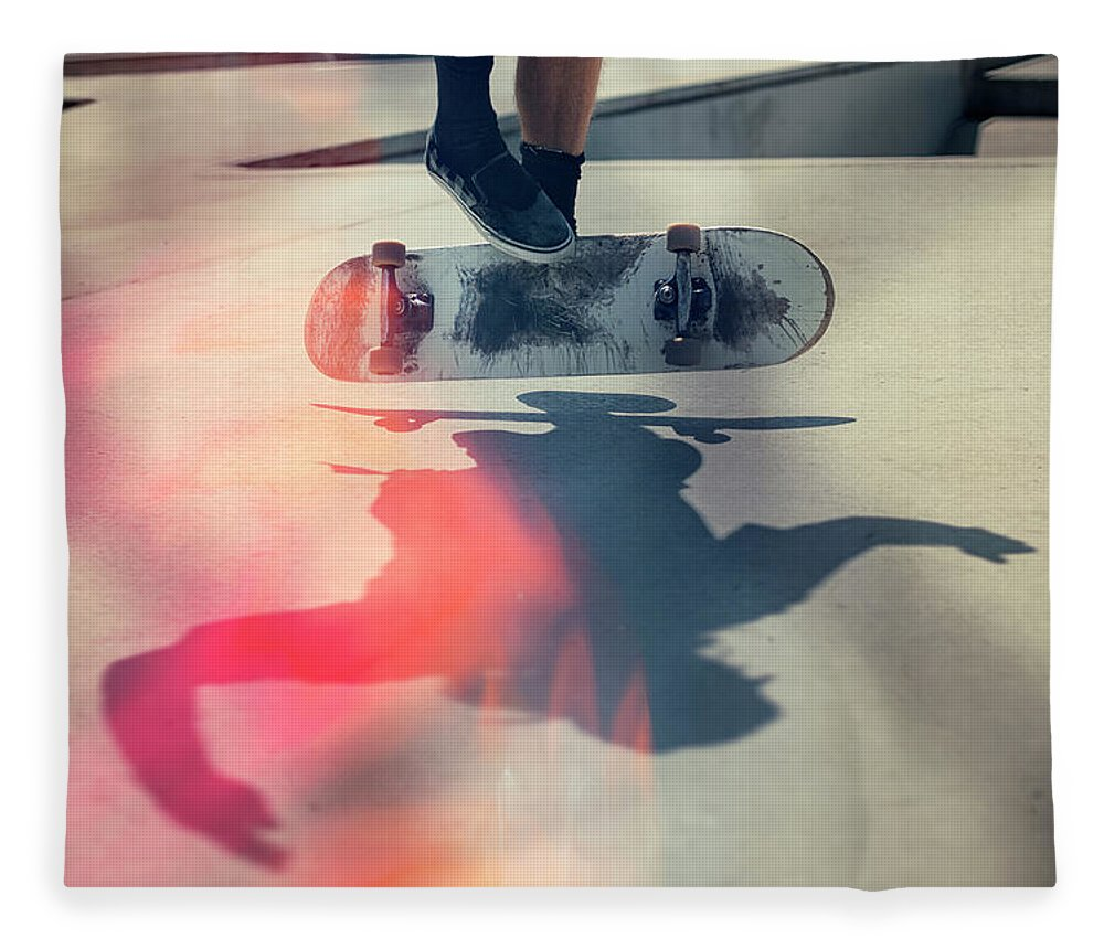Cool Attitude Fleece Blanket featuring the photograph Skateboarder Doing An Ollie by Devon Strong