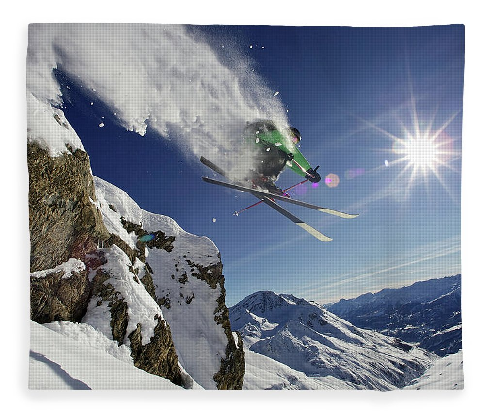 Young Men Fleece Blanket featuring the photograph Skier In Midair On Snowy Mountain by Michael Truelove