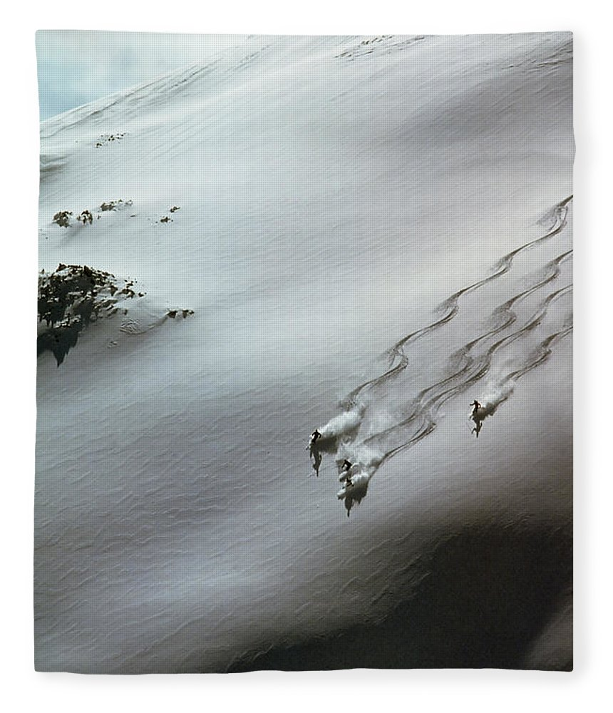 Shadow Fleece Blanket featuring the photograph Skier Moving Down In Snow On Slope by John P Kelly