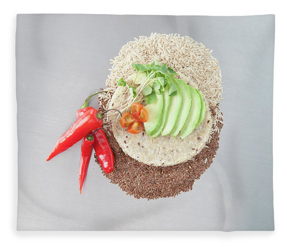 Flax Seed Fleece Blanket featuring the photograph Sliced Avocado And Peppers With Grains by Laurie Castelli