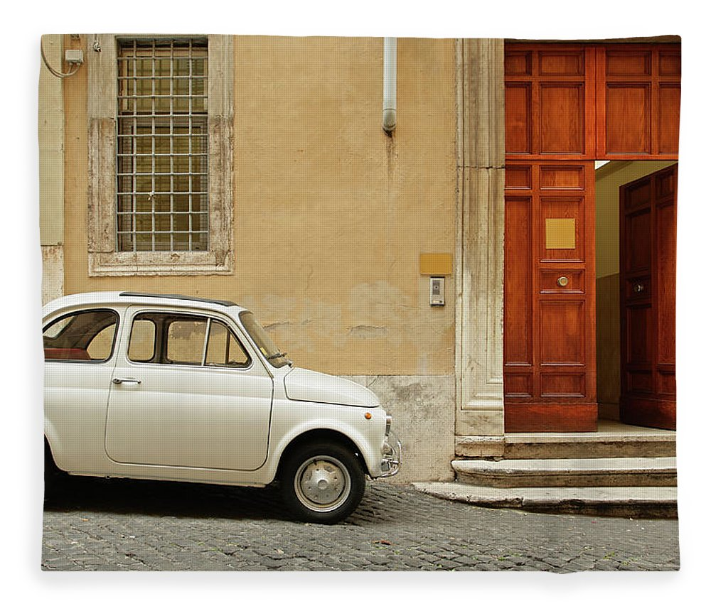 Steps Fleece Blanket featuring the photograph Small Coupe Parked Near A Doorway On A by S. Greg Panosian