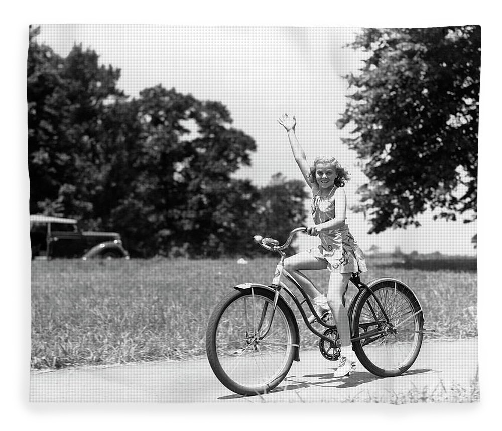 Bicycle Seat Fleece Blanket featuring the photograph Smiling Girl Wearing A Jumper Short Set by H. Armstrong Roberts