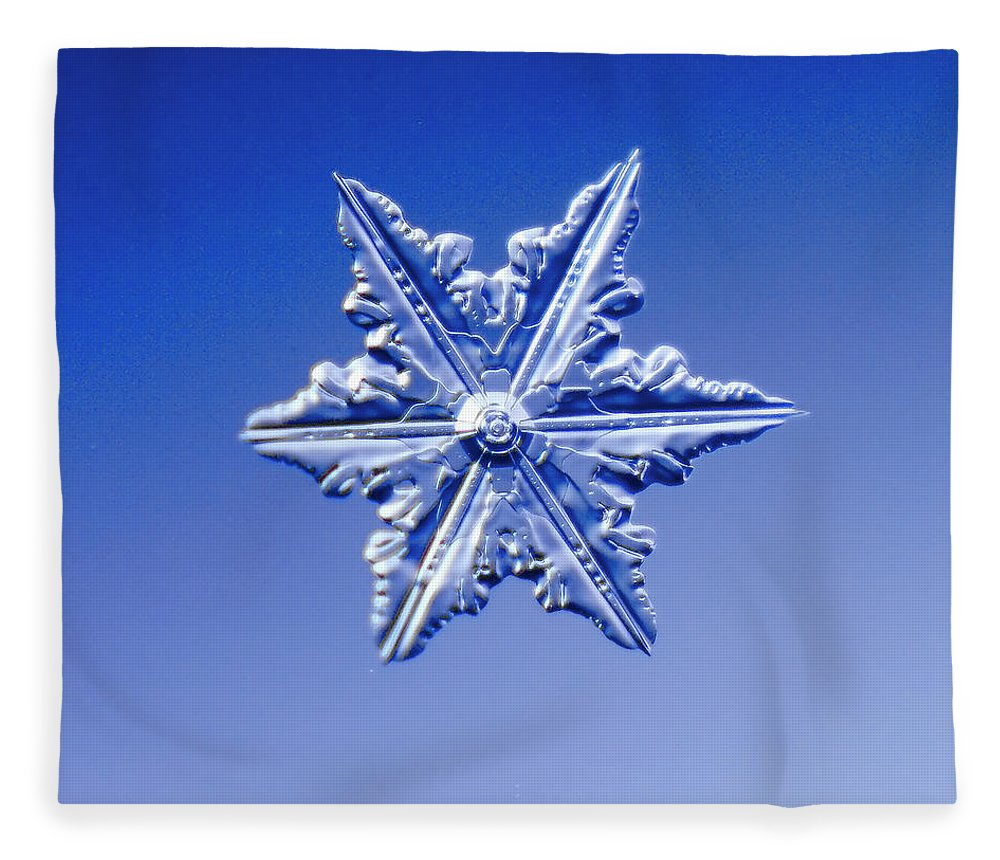 Snow Fleece Blanket featuring the photograph Snowflake On Blue Background by Fwwidall