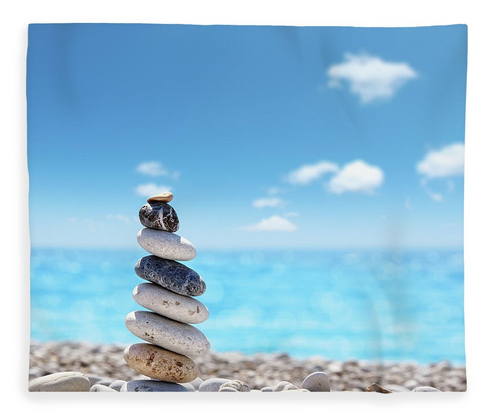 Water's Edge Fleece Blanket featuring the photograph Stone Balance On Beach by Imagedepotpro