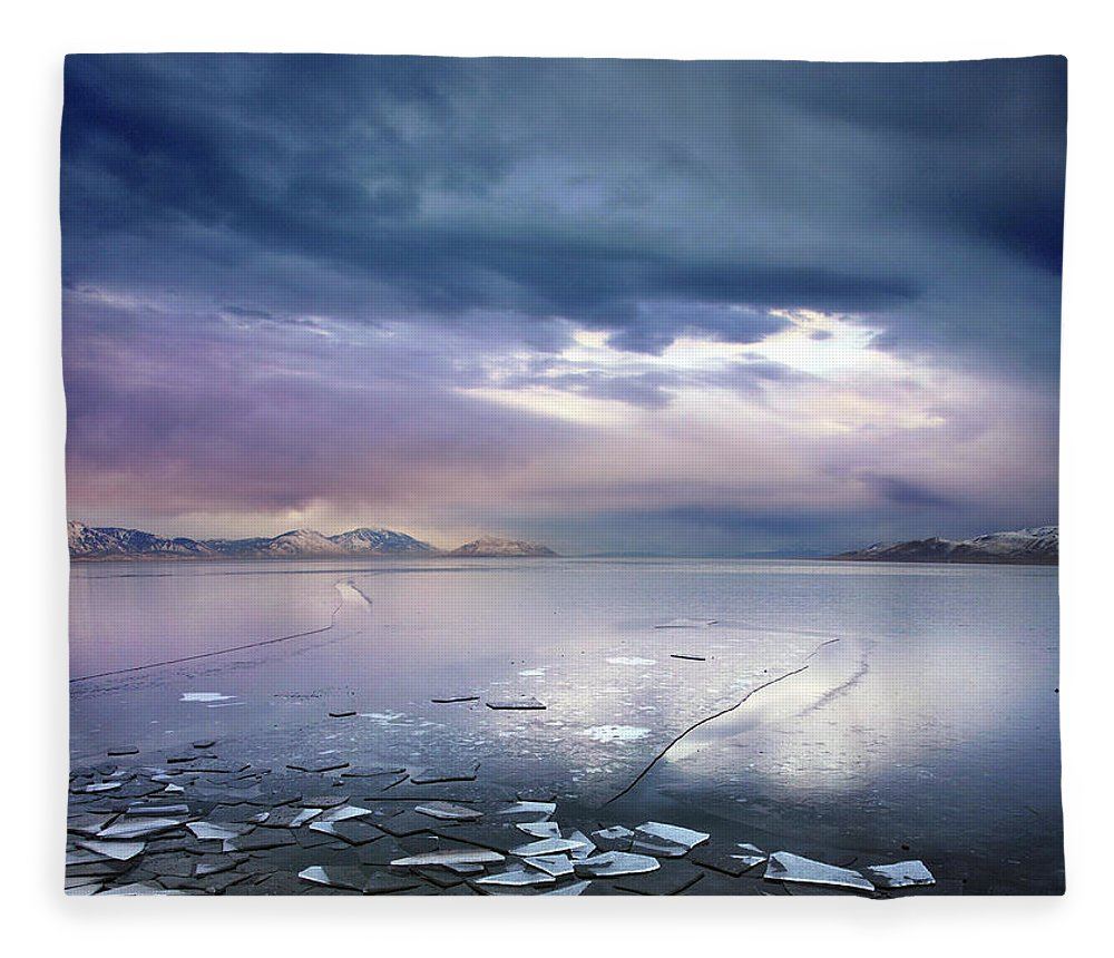 Scenics Fleece Blanket featuring the photograph Storm Clouds Clearing Over Icy Lake by Utah-based Photographer Ryan Houston