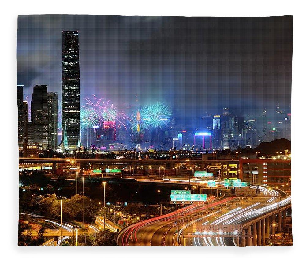 Firework Display Fleece Blanket featuring the photograph Street Light Crosses Firework by Eddymtl