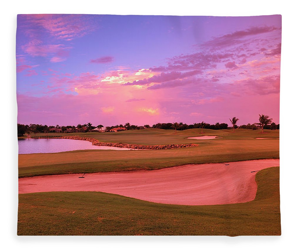 Sand Trap Fleece Blanket featuring the photograph Sunrise View Of A Resort On A Golf by Rhz