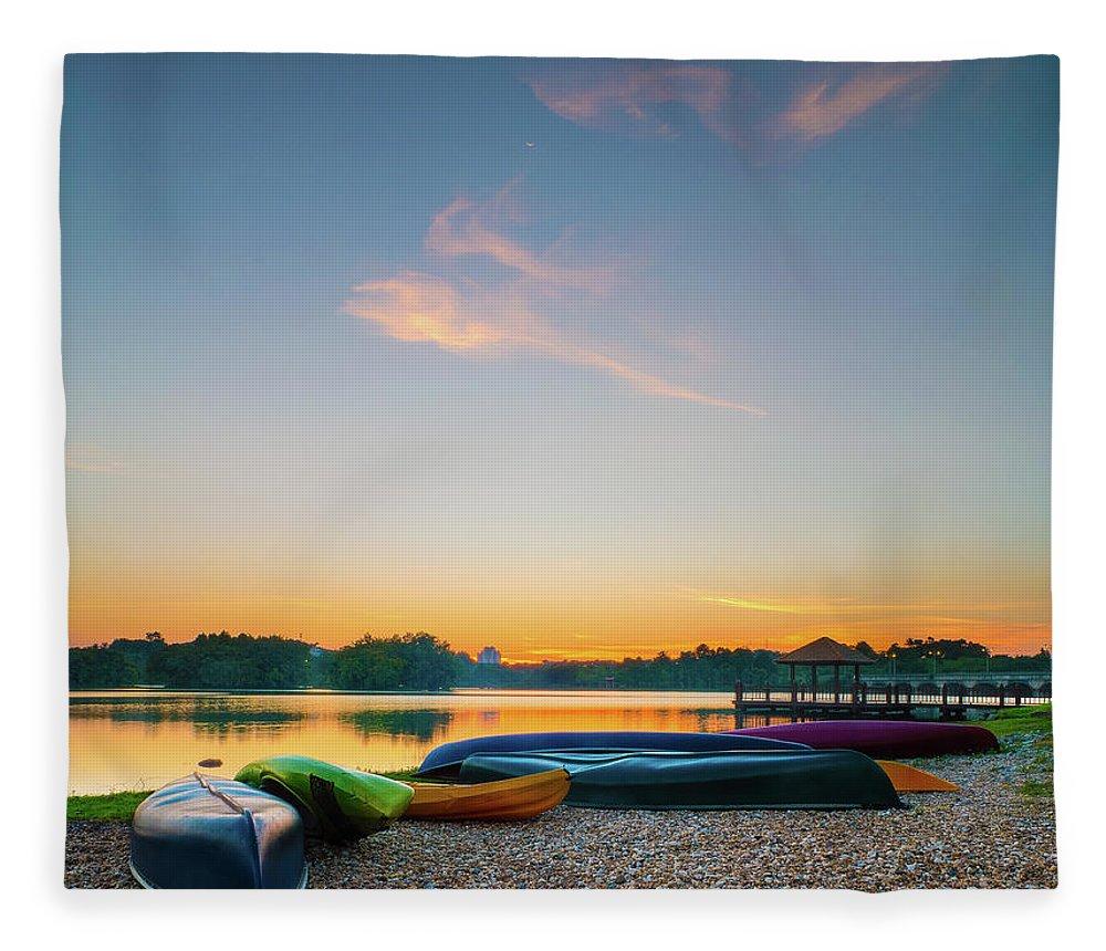 Tranquility Fleece Blanket featuring the photograph Sunset At Kayak Putrajaya Lake by Muhammad Hafiz Bin Muhamad