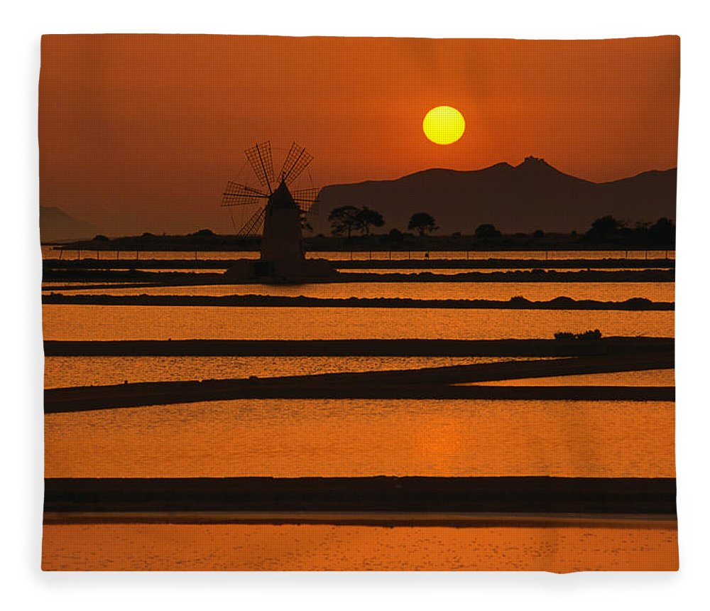 Environmental Conservation Fleece Blanket featuring the photograph Sunset Over The Saltpans And A Windmill by Dallas Stribley
