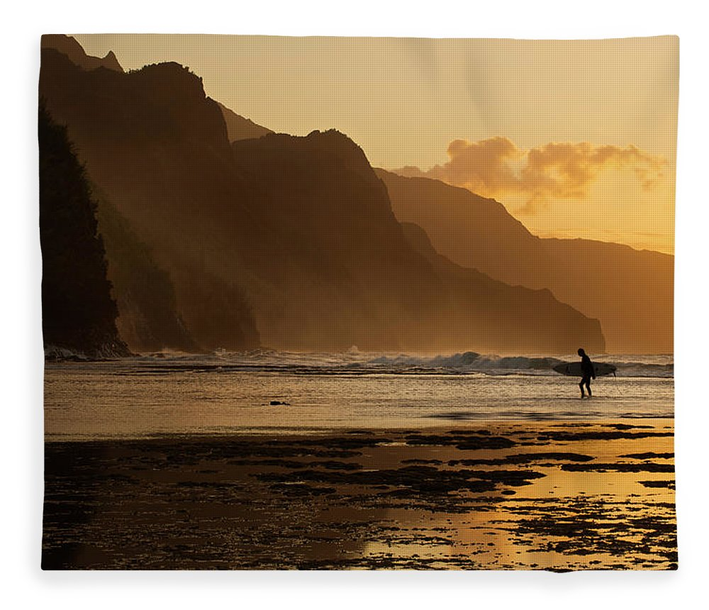Tranquility Fleece Blanket featuring the photograph Surfer On Beach And Na Pali Coast Seen by Enrique R. Aguirre Aves