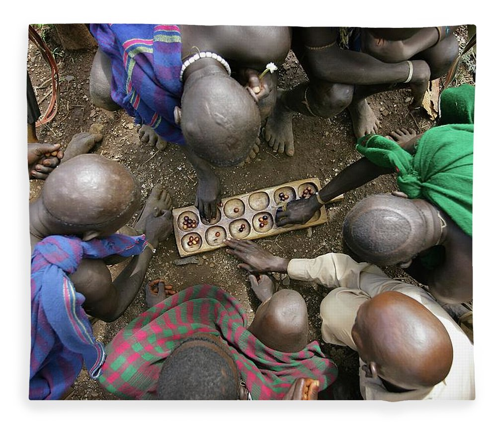 Nut Fleece Blanket featuring the photograph Suri Tribal Game Of Mancala Seen From by Timothy Allen