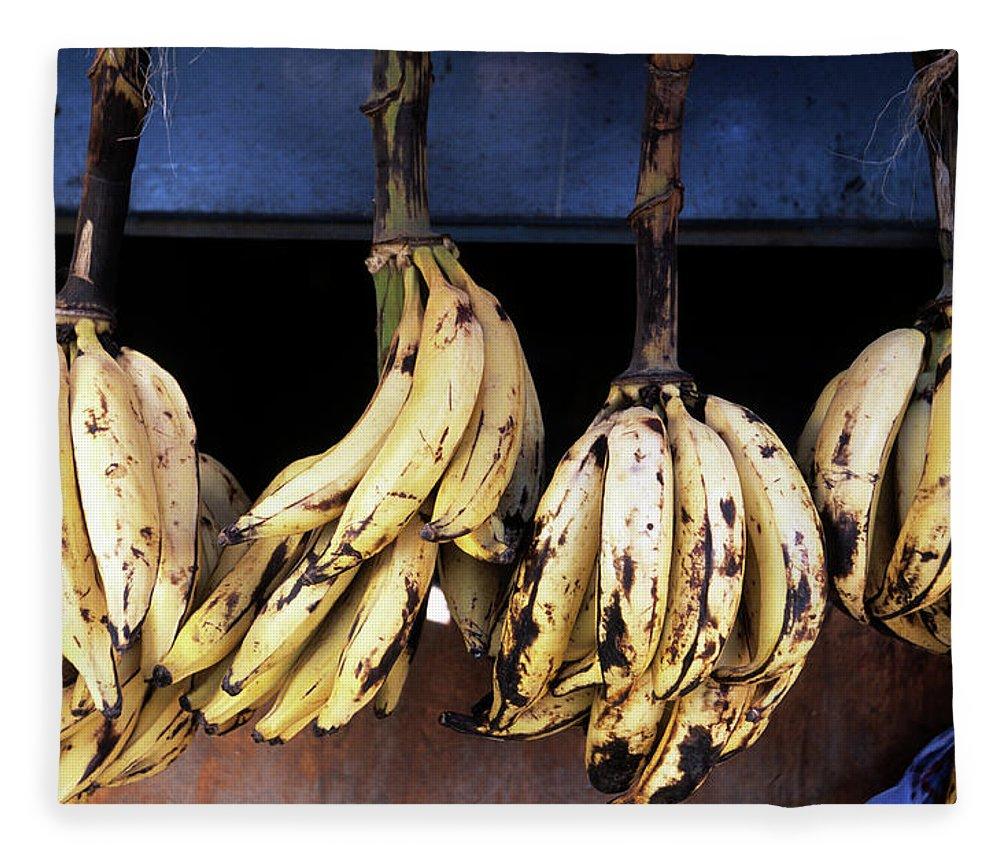 Hanging Fleece Blanket featuring the photograph Tanzania, Zanzibar, Bananas For Sale In by John Seaton Callahan